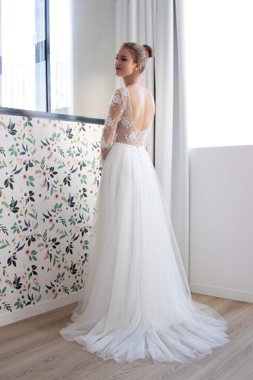 La robe de mariée Paloma a un joli tombé grace à sa surjupe en tulle fin et souple.